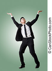 Holding pose of Asian business man