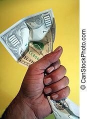 Holding salary - human hand holding 100 dollars