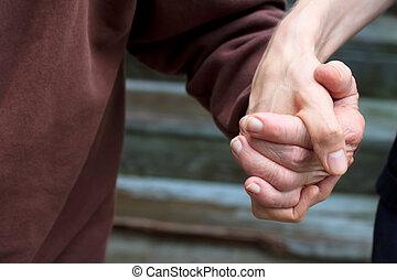 Holding senior lady's hand