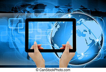 holding tablet computer on technology background