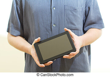 holding tablet pc.