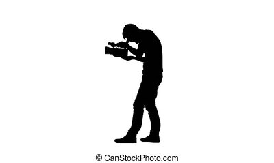 Holding the camera in hands of operator makes videotaping....