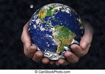 A pair of hands holding the Earth with the moon in the background. Blue Marble picture courtesy of NASA, see for terms of use