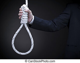Holding the noose - A man on a suit holds a hangman\\\'s...