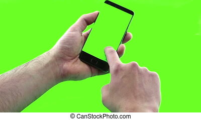 holding touchscreen device, close-up of male hand using a smart phone with chroma key, green screen on background, communication using smartphone technology concept