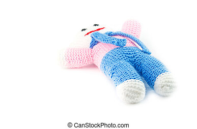 knitted doll - holds knitted doll isolated on white