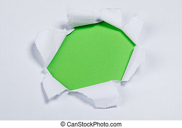 Hole in a white paper