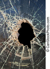 Hole in Glass - Hole smashed in thick, dirty glass with dark...