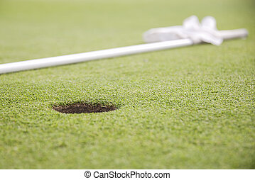 hole on green of golf course