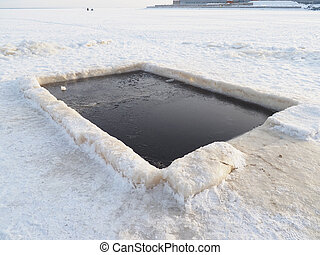 hole on the lake in winter