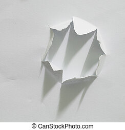 Hole ripped in paper.
