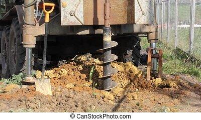 holes boring in ground with drilling rig machine