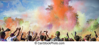 Holi Festival of Colors - Celebrants dancing during the...