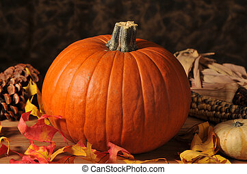 Holiay pumpkin - A pumpkin with autumn leaves and pine cones