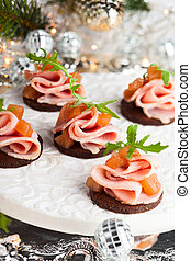 Holiday appetizer - Slices of bread with ham and pear ...