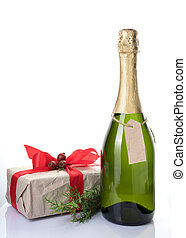 Holiday background with a gift box, alcohol and a coniferous branch on a light background.