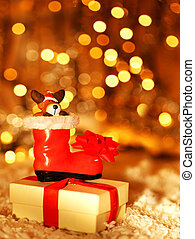 Holiday background with cute Santa boot decoration
