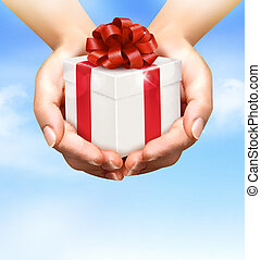 Holiday background with hands holding gift boxes. Concept of...