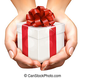 Holiday background with hands holding gift boxes. Concept of giving presents