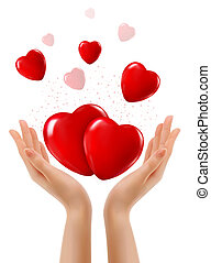 Holiday background with two hands and red hearts. Vector