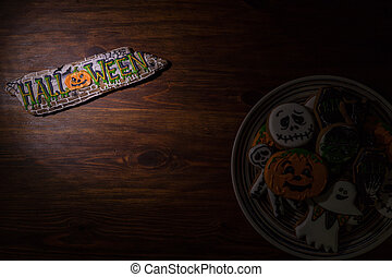 Holiday biscuits for Halloween of different shapes on a wooden table