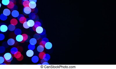 Holiday blinking lights, over black background with copy...