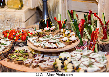 holiday buffet table served by different canape, sandwiches, snacks ready for eating in restaurant. Traditional Ukrainian food
