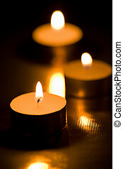 holiday candles burning in the dark