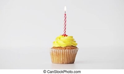birthday cupcake with burning candle