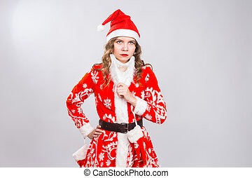 Holiday, Christmas and joke concept - Serious angry woman in the image of a bad Santa on white background