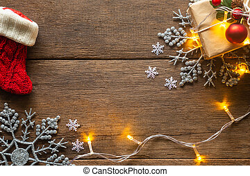 Holiday Christmas card background with festive decoration ball, stars, snowflakes, gift box, pine cones on a wood background from Flat lay, top view. Space for text Merry Christmas and happy New Year