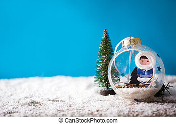 Holiday Christmas decoration on snow and blue background.