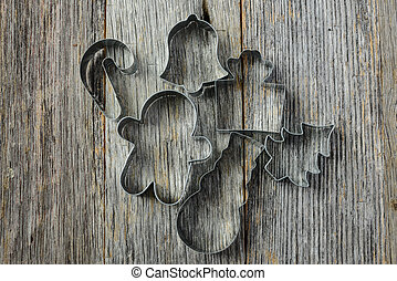 Holiday Cookie Cutters on Rustic Wood Background