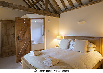 Holiday Cottage Bedroom Interior with Bathroom Viewed from Corner