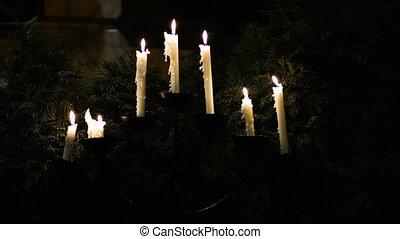 Holiday decoration, burning candle on Christmas tree.