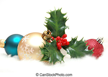 Holiday Decorations - A holiday scene of holly and golden ...