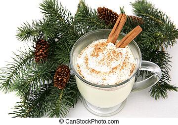 Holiday Eggnog - A mug of eggnog garnished with whipped...