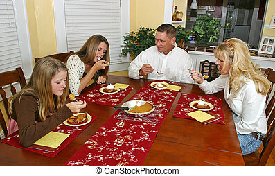 Holiday Family Dessert - A family sitting around the dinner...