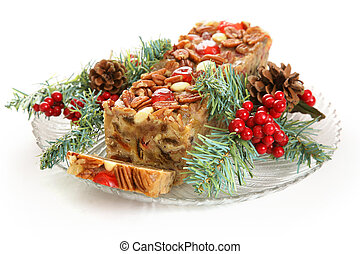 Holiday Fruit Cake Isolated on White - Christmas fruitcake...
