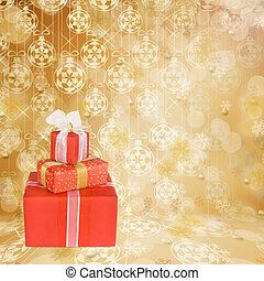 Holiday gift boxes decorated with bows and ribbons on the bright abstract background