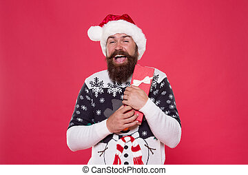 Holiday gift delivery. Happy santa hold christmas gift. Bearded man got new year gift. Holiday gift. Christmas and New Year celebration. Boxing day