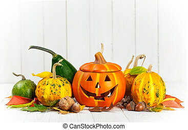 Holiday Halloween autumn decoration with jack-o-lantern pumpkins
