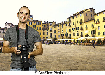 holiday in piazza anfiteatro Lucca - young photographer in...