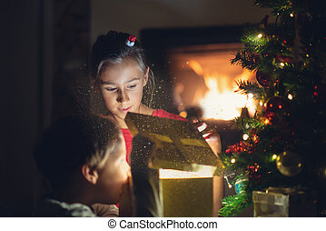 Holiday magic of opening Christmas present