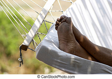 Man resting on hammock.