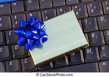 Holiday gift box on a keyboard concepts of holiday online shopping