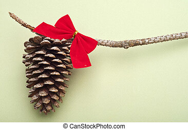 Holiday Pinecone with a Red Bow on a Green Background