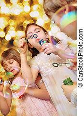 holiday portrait of happy children against bright background