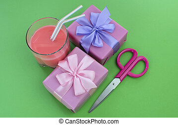 Holiday poster Boxes with gifts a glass of milkshake a bright green background.