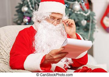 Santa Claus sitting in the arm chair